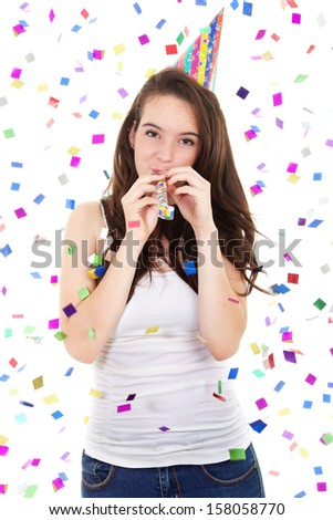 Stock image of casual teen in a party with hat and blowout over white background - stock photo