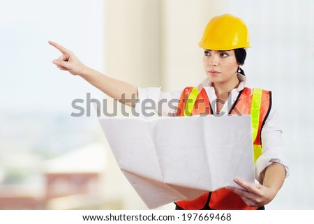 Stock image of female architect or engineer on construction site - stock photo