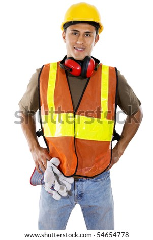 Stock image of hispanic construction worker over white background - stock photo