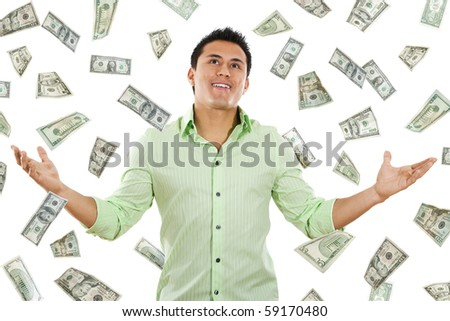 Stock image of money falling around young man