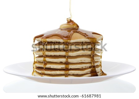 Stock image of stack of pancakes with butter and syrup over white background - stock photo