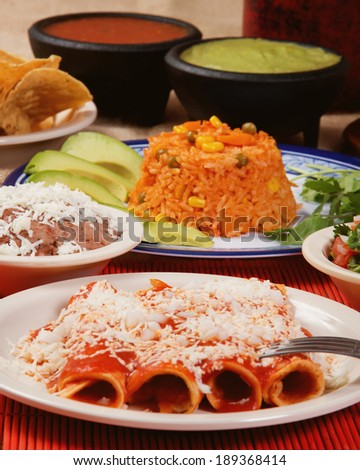 Stock image of traditional mexican red enchilada dinner - stock photo