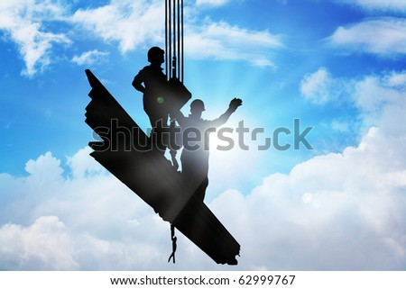 Stock image of two person on iron bars being held up by mega crane