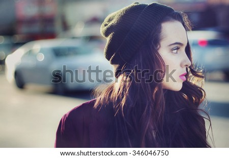 Stock image portrait of urban teen walking outdoors with a blank stare - stock photo
