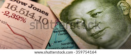Stock Market Graph and a Chinese Yuan banknote (figuring Mao Zedong) on top of a map of China. Red downtrend indicates the stock market recession period - stock photo