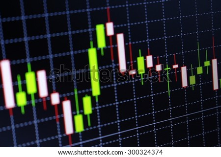 Stock market graph and bar chart price display. Abstract financial background trade colorful. Display of quotes pricing graph visualization. - stock photo
