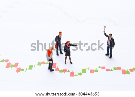 stock market graph, data analyzing with miniature people