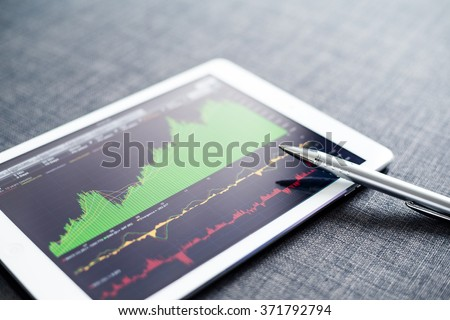 Stock market graph on tablet pc - stock photo