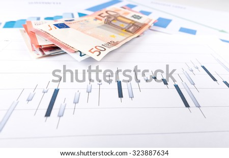 Stock market graph with bank notes