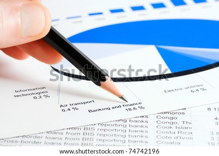 Stock market reports analyzing - stock photo