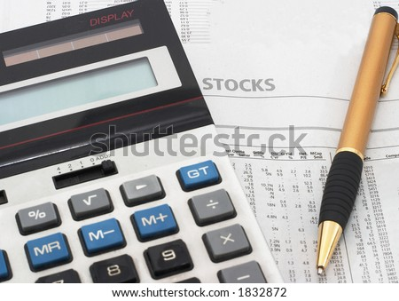 Stock market table analysis, calculator and pen indicates research and analysis, horizontal orientation. - stock photo
