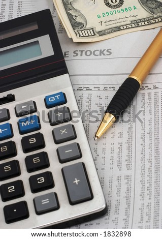 Stock market table analysis, calculator and pen indicates research and analysis, with cash, vertical orientation, cash indicates winnings, greed - stock photo
