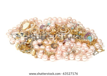 Stock of gold jewelry, isolated on white background