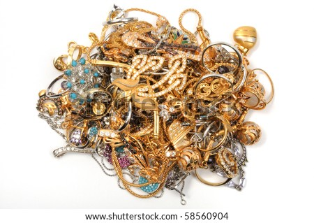 Stock of gold jewelry on white background,