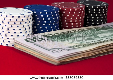 Stock of poker chips and cash money