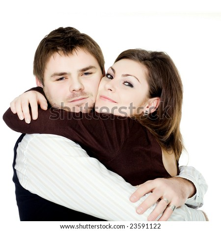Stock photo: an image of a tight embrace of a young couple