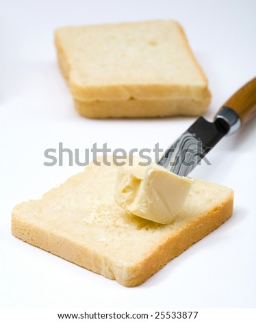 Stock photo: an image of butter on bread and a knife