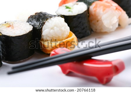 Stock Photo: Asia and food: prepared sushi on a plate
