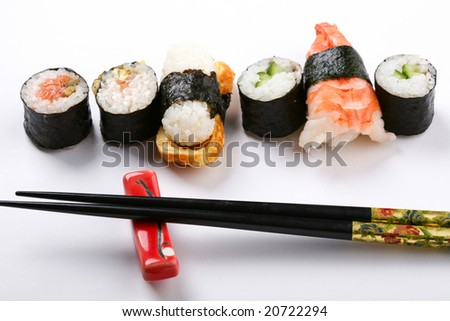 Stock Photo: Asia and food: prepared sushi on white