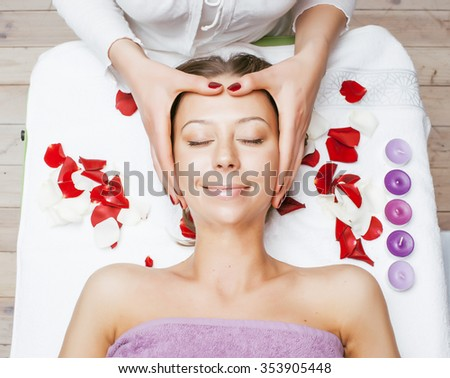 stock photo attractive lady getting spa treatment in salon, massage doctor smiling - stock photo