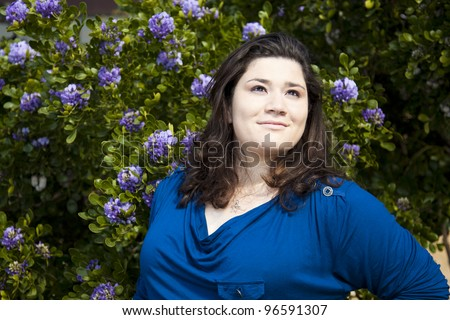 Stock photo of a casually dressed woman in an outdoor urban environment