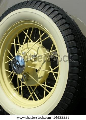 Stock photo of a vintage car wheel - stock photo