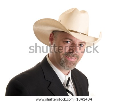 Stock photo of a well dressed businessman wearing a cowboy hat, isolated on white.