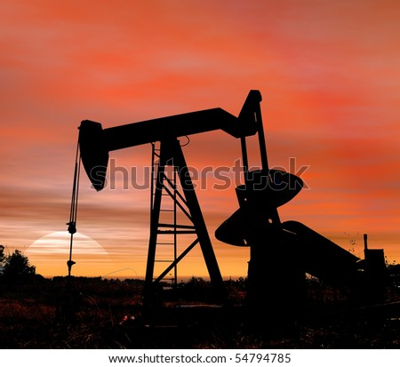 Stock photo of an oil pumper at sunset in near square format