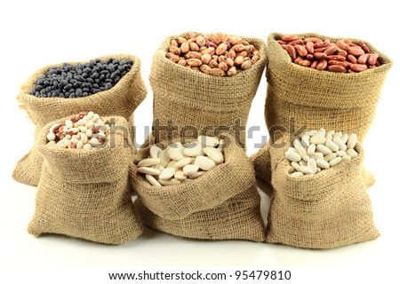 Stock Photo of Different kinds  Bean Seeds (legume, pulse) in burlap bags (sacks) front view  over white background. - stock photo