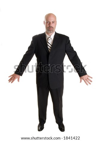 Stock photo of the front side of a well dressed businessman holding his arms out to his side in a gesture as if he were holding back a crowd.  Full length, isolated white. - stock photo