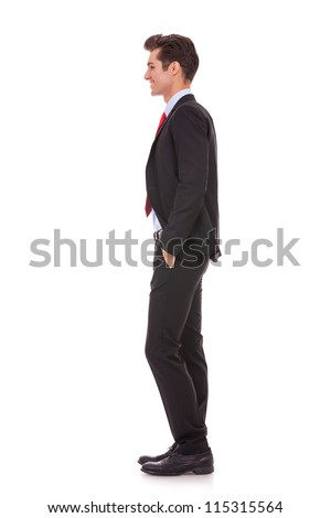 Stock photo of the side view profile of a well dressed business man smiling. Full length, isolated white. - stock photo