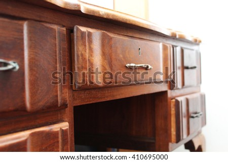 Stock photo side view of wooden desk drawer