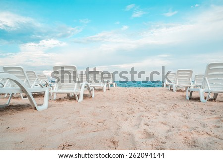 Stock photo the sunbeds on the sea beach. - stock photo
