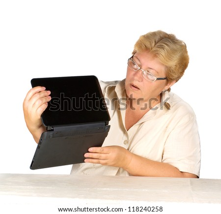 stock photo woman is working on laptop.elderly woman is not able to use laptop.