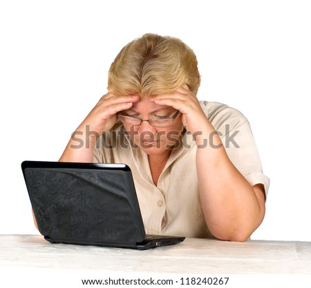 stock photo woman is working on laptop. elderly woman thinking hard at work.