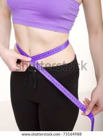 stock photo woman measuring her slim body isolated on white background