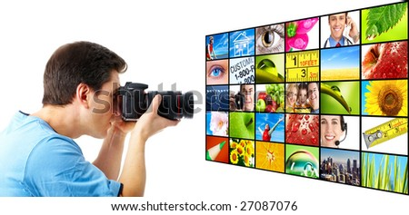 Stock photographer taking photo. Isolated over white background - stock photo