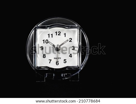 stock picture of a white face clock on black background - stock photo