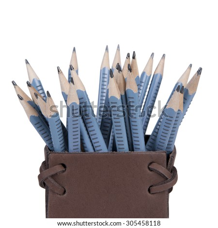 Stock picture of blue pencils in a brown leather box, on white, isolated background - stock photo