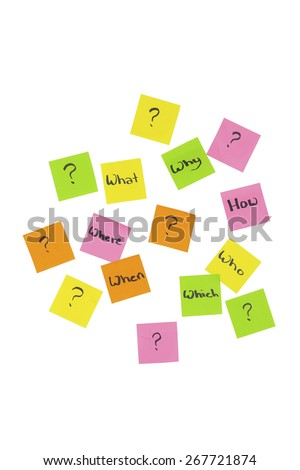 Stock picture of colored note it stickers with question words and question marks written on them, on a white background - stock photo