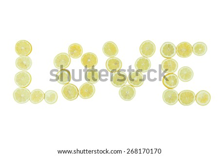 Stock picture of sliced green lime, forming the word love, on a white background - stock photo