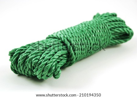 stock pictures of a coil and loop of green rope - stock photo