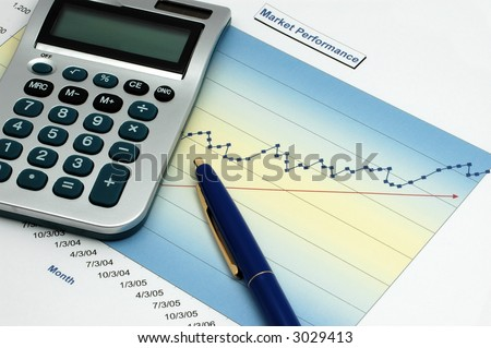 Stock Report with Calculator and Blue Pen