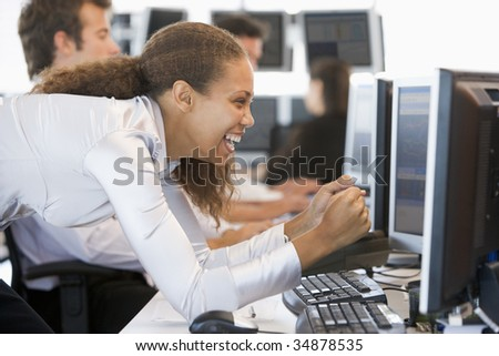 Stock Trader Overjoyed Looking At Monitor