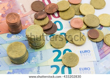 Stockes Coins and Euro Bills of 10 and 20