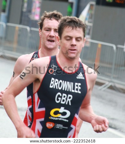 STOCKHOLM - AUG 23: Brownlee brothers in the lead of the Men's ITU World Triathlon series event Aug 23, 2014 in Stockholm, Sweden - stock photo