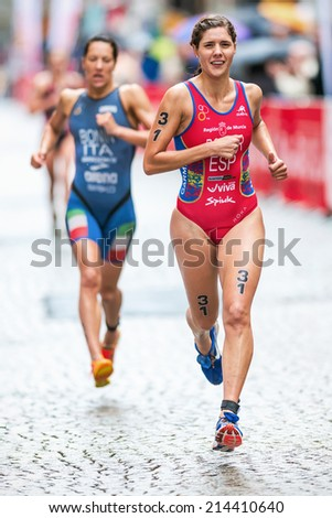 STOCKHOLM - AUG, 23: Carolina Routier from Spain leading a group at the cobblestone roads of the old town in the Womens ITU World Triathlon Series event 23, 2014 in Stockholm, Sweden - stock photo
