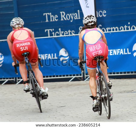 STOCKHOLM - AUG 23, 2014: Celine Scharer and Ainhoa Murua cycling in a curve in the Women's ITU World Triathlon series event August 23, 2014 in Stockholm, Sweden - stock photo