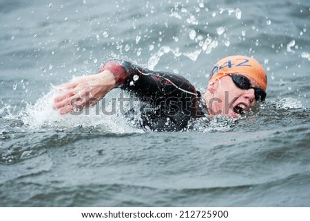 STOCKHOLM - AUG, 23: Closeup of a Conor Murphy in the mens swimming in the cold water at the Mens ITU World Triathlon Series event Aug 23, 2014 in Stockholm, Sweden  - stock photo
