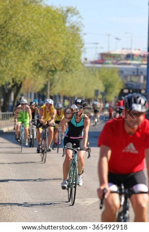 STOCKHOLM - AUG 23, 2015: Group of colorful cyclists cycling on asphalt on a avenue at ITU World Triathlon event in Stockholm, 2015 - stock photo